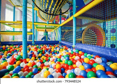 Modern children playground indoor. Inside the colorful plastic structure for active games and development of motor skills. Large dry pool with colored balls. Kids playground for gym in kindergarten.