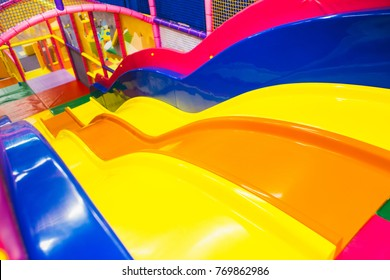 A modern children playground indoor with long slide . children's playground . kindergarden playground