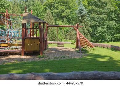 Modern children playground in park, wooden playground