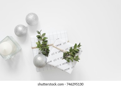 Modern Christmas decor. Black, white and green. Scandinavian style. Balls and boxwood