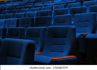 Modern cinema hall empty and blue comfortable seats, movie theater seats or chair
