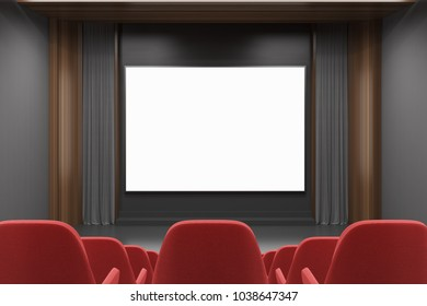 Modern cinema interior with gray and dark wooden walls, and red chairs. A screen. A rear view. 3d rendering mock up