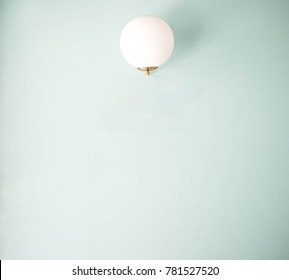 Modern circle lamp isolate on pastel blue background with copy space
