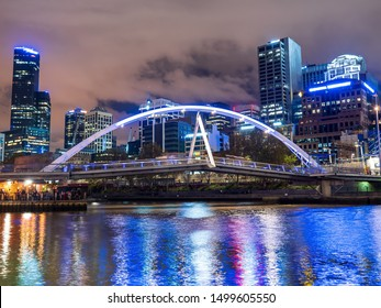 Modern city bridge over the Yarra river in Melbourne, Australia at night. Trademarks removed.