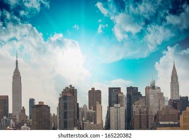 Modern city buildings and skyscrapers. Metropolis skyline with blue sky.