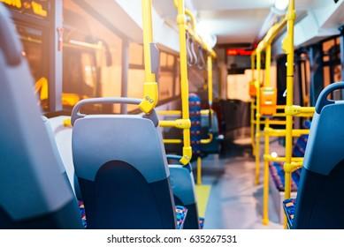 Modern city bus interior and seats. Public transport