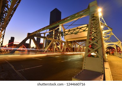 The modern city highway Bridges night landscape car light trails arc in tianjin