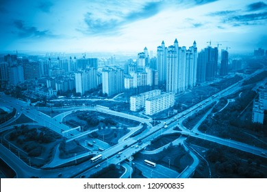 modern city with highway junction at dusk