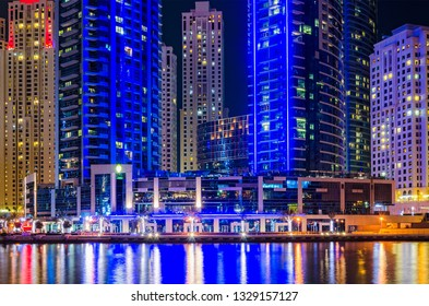 Modern city at night. Skyline of Dubai Marina at night reflected in water, United Arab Emirates, Middle East