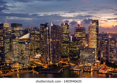 Modern city skyline. Business district, blue sky and night view for skyscrapers