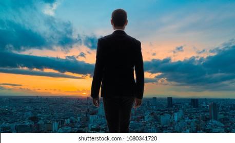 Modern city skyline and businessperson.