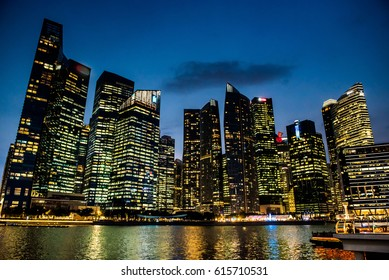 A modern city skyline at night time
