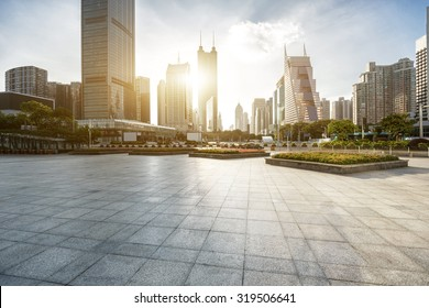 modern city square and skyscrapers under sunshine