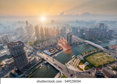 modern city in sunset, aerial view of tianjin cityscape