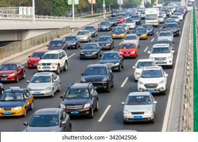 modern city traffic jam in the rush hour??Fuzzy automotive background