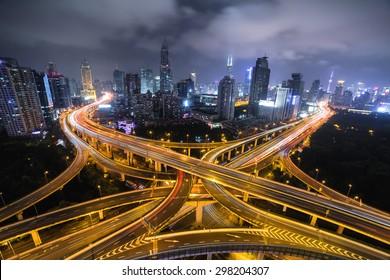 Modern city traffic road night. Aerial Transport road junction.