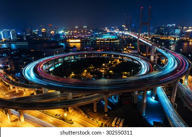 Modern city traffic road at night. transport road junction on the bridge.