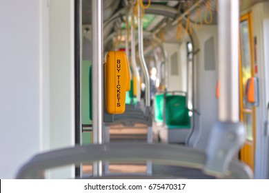 Modern city tram interior with electronic ticket validation machine