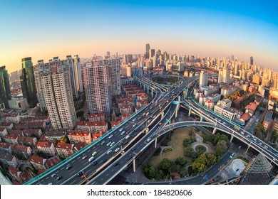 modern city viaduct junction by fisheye view at dusk in shanghai