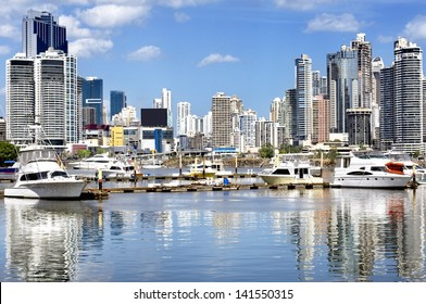 Modern city view - skyscrapers and luxury yachts with water reflection - Panama City