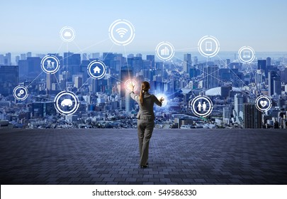 modern cityscape and business person, IoT(Internet of Things), ICT(Information Communication Technology), abstract image visual