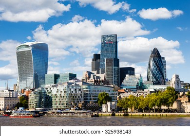 Modern cityscape of London (Europe) with blue sky with white clouds