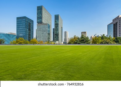 modern cityscape and skyline  from meadow in park
