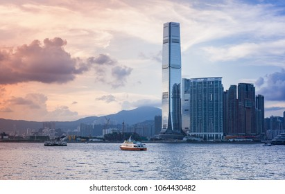 Modern cityscape with skyscrapers. International Commerce Centre of Hong Kong under colorful evening sky