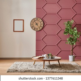 Modern claret red wall detail with white background, grey sofa and pillow, white bookshelf middle table and orange lamp style, frame and chair decor.