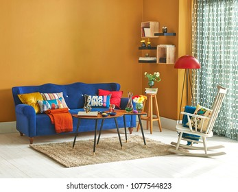 modern and classic interior living room style. Yellow detail in the room with bookcase. Decorative furniture style.