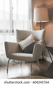 Modern classic style armchair with standing lamp at the corner of living room