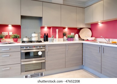 modern clean stylish kitchen with utensils, recipe book and ingredients ready on the worktop