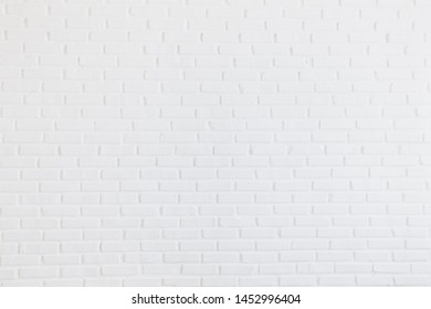 Modern Clear white brick tiles wall texture background. Kitchen wallpaper concept.