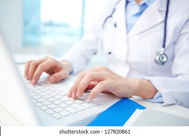 Modern clinician inputting diagnosis into an online data base