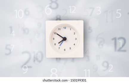 Modern clock with numbers on the side comming out