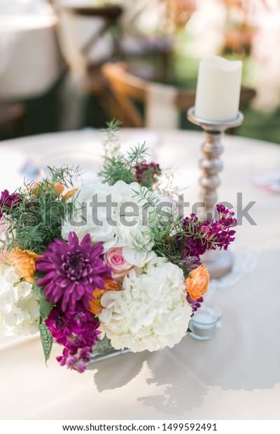 Modern Colorful Wedding Flower Table Arrangement Stock Photo