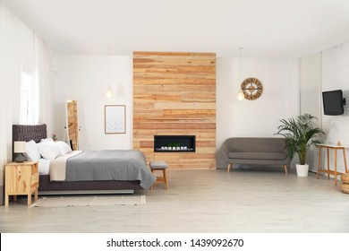Modern comfortable bed and sofa in room. Interior design