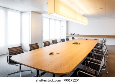 Modern and comfortable meeting room of overseas corporation, equipped with contemporary furniture and latest communications technology.