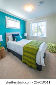 Modern comfortable, nicely decorated children bedroom painted in turquoise. Interior design. Vertical.