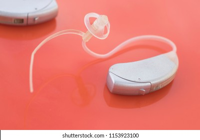 Modern compact in the ear digital audiophone hearing aid for deaf  people to hear.