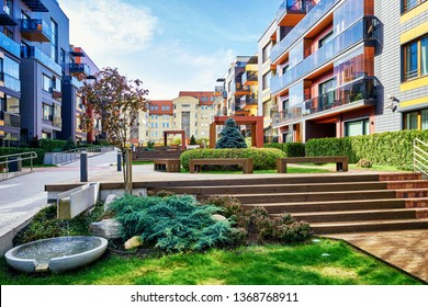 Modern complex of apartment residential buildings and decorative water fountain. With outdoor facilities.