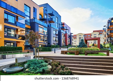 Modern complex of apartment residential buildings. With staircase, fountain, and other outdoor facilities.