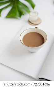modern composition with a cup of coffee in white color