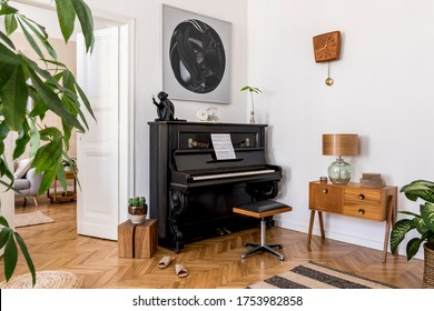 Modern composition of home interior with stylish black piano, design furnitures, carpet, cacti, plants, decoration, mock up painitngs and elegant personal accessories in home decor.