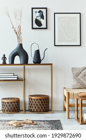Modern composition in stylish living room interior with design armchair, mock up poster frames, carpet, decoration, dried flowers, rattan basket and elegant accessories in home decor.