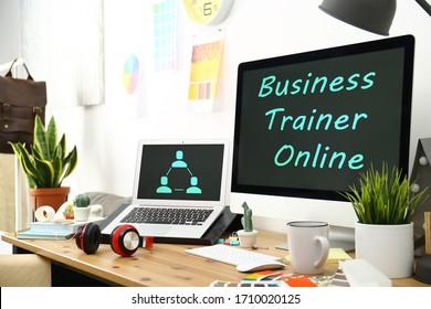 Modern computer and laptop on desk indoors. Business trainer online