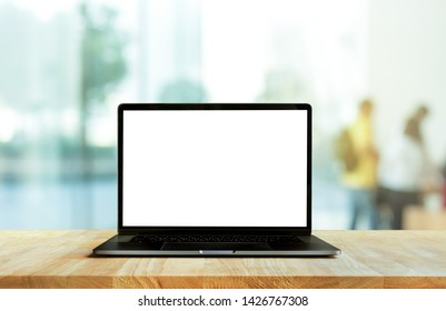 Modern computer,laptop with blank screen on counter bar(retail store shop)and window view backgrounds