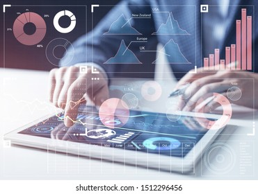 Modern computing in business analytics. Businessman hand touching virtual screen. Online project management and business intelligence. Statistic diagrams visualization and financial growth concept