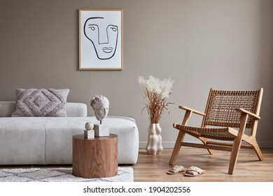 Modern concept of living room interior with design modular sofa, rattan armchair, dried flowers in vase, coffee table, decoration and elegant personal accessories in stylish home decor. Template.