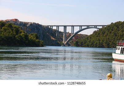 Modern concrete arch the Krka bridge over the Krka River near town Skradin, Dalmatia, Croatia.